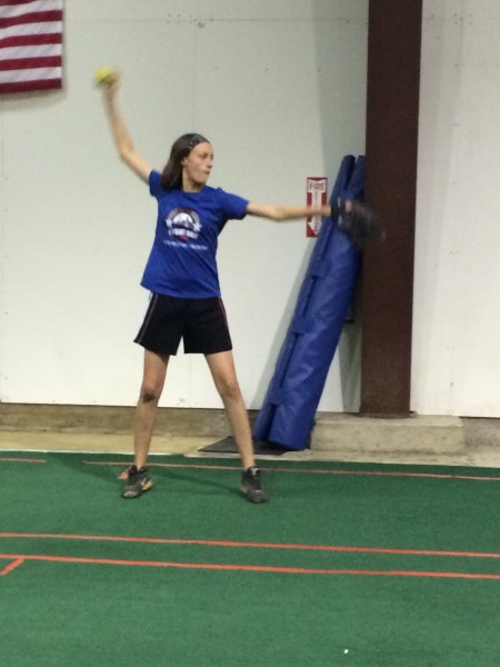 Warming up at her pitching lesson.